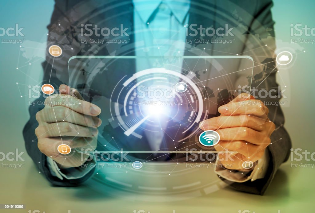 woman looks transparent monitor panel that indicates technological graphics, IoT(Internet of Things), ICT(Information Communication Technology), CPS(Cyber-Physical Systems), abstract stock photo