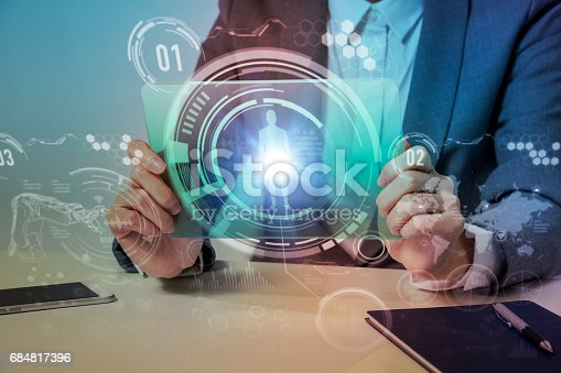 693586040istockphoto woman looks transparent monitor panel that indicates technological graphics, futuristic GUI(Graphical User Interface), IoT(Internet of Things), technological abstract 684817396