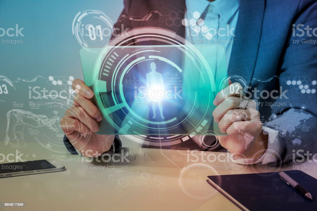 woman looks transparent monitor panel that indicates technological graphics, futuristic GUI(Graphical User Interface), IoT(Internet of Things), technological abstract stock photo