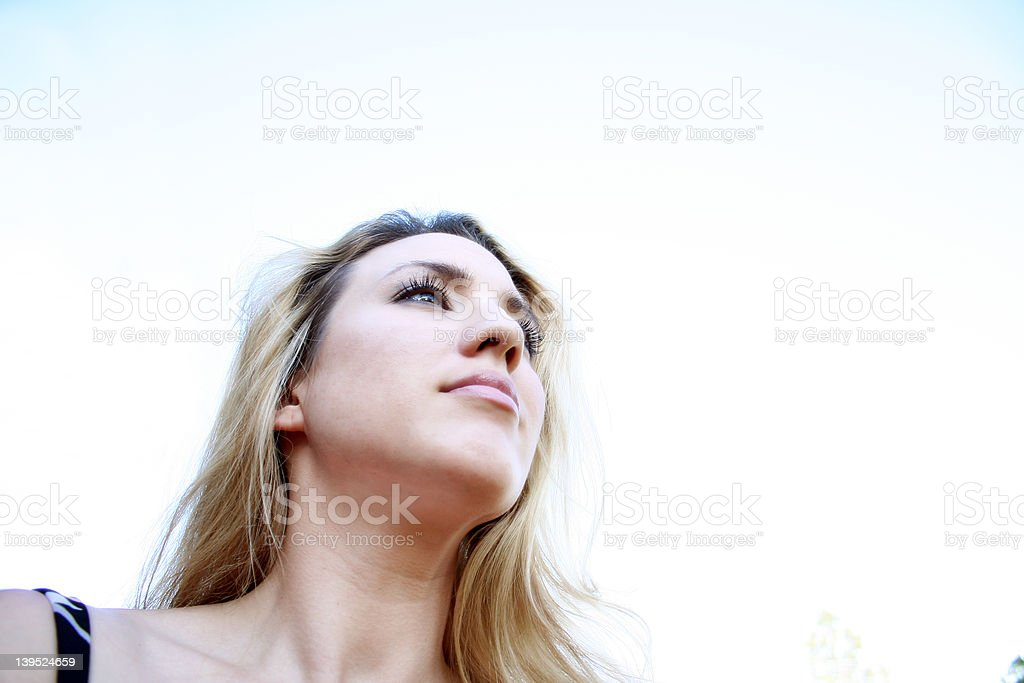 Woman looks Up stock photo