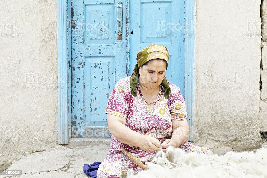 Woman loosening wool royalty-free stock photo