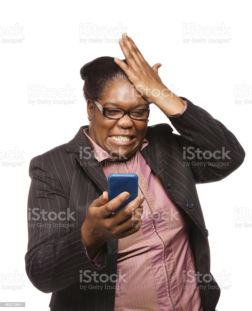 Woman losing at video games on mobile phone stock photo