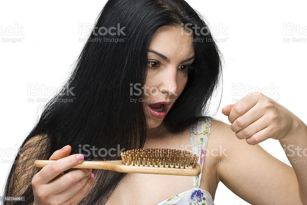 Woman losing hair on hairbrush stock photo