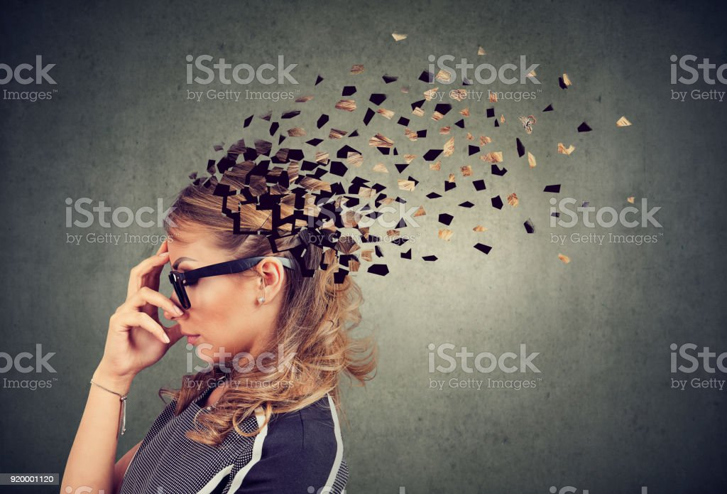 Woman losing parts of head as symbol of decreased mind function. stock photo