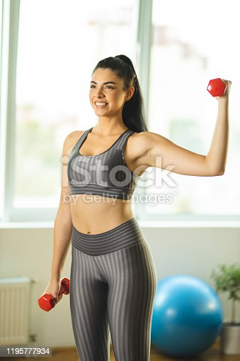 1035512048istockphoto Woman losing weight at home 1195777934