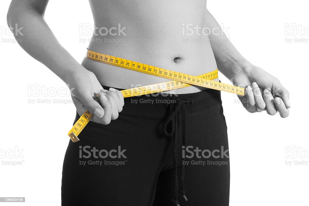 Woman losing weight stock photo