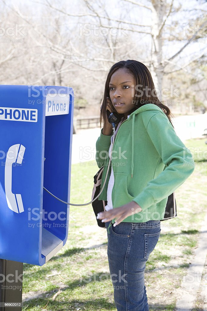 Woman Lost at a Pay Phone. royalty-free stock photo