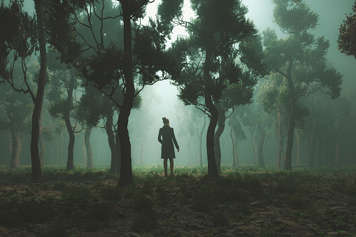 Woman lost in fantasy forest at night