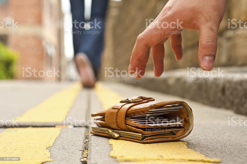 woman lost purse/wallet, walking away stock photo