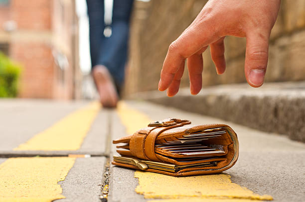 woman lost purse/wallet, walking away - lost stock photos and pictures