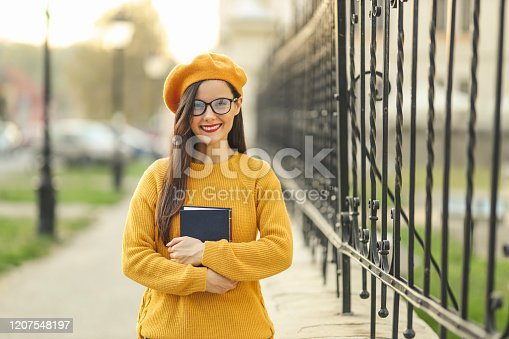 521911045 istock photo Woman loves fashion and books 1207548197