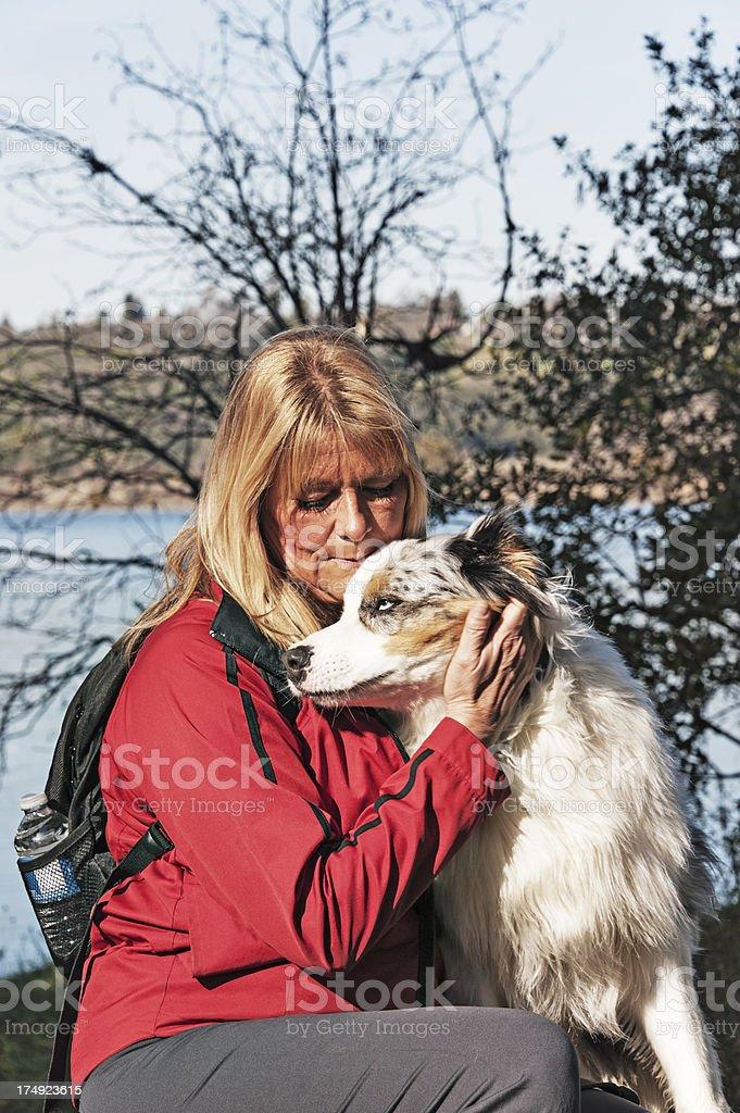 Woman Loves Pet royalty-free stock photo