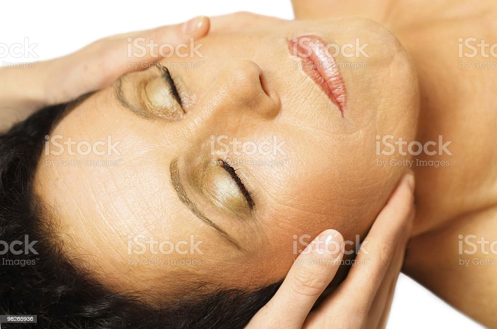 Woman lying, gets massage on her face royalty-free stock photo