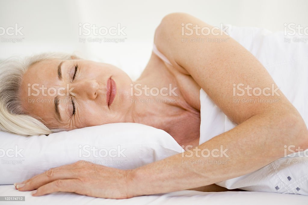 Woman lying in bed sleeping royalty-free stock photo