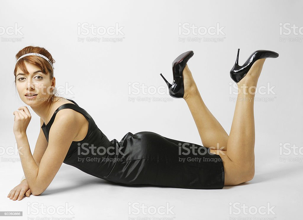 Woman lying in black shoes heeled stock photo