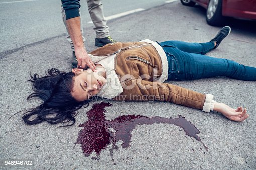 istock Woman lying in blood on the road 948946702
