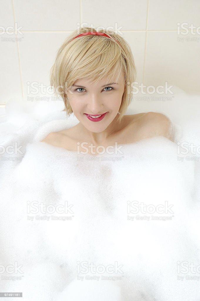 woman lying in bubble bath . royalty-free stock photo