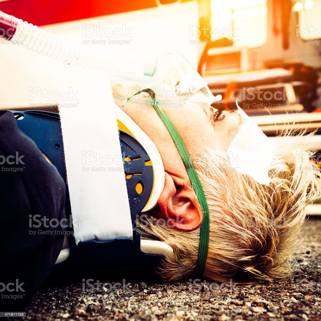 Woman Lying In Front As An Ambulance After Car Accident royalty-free stock photo