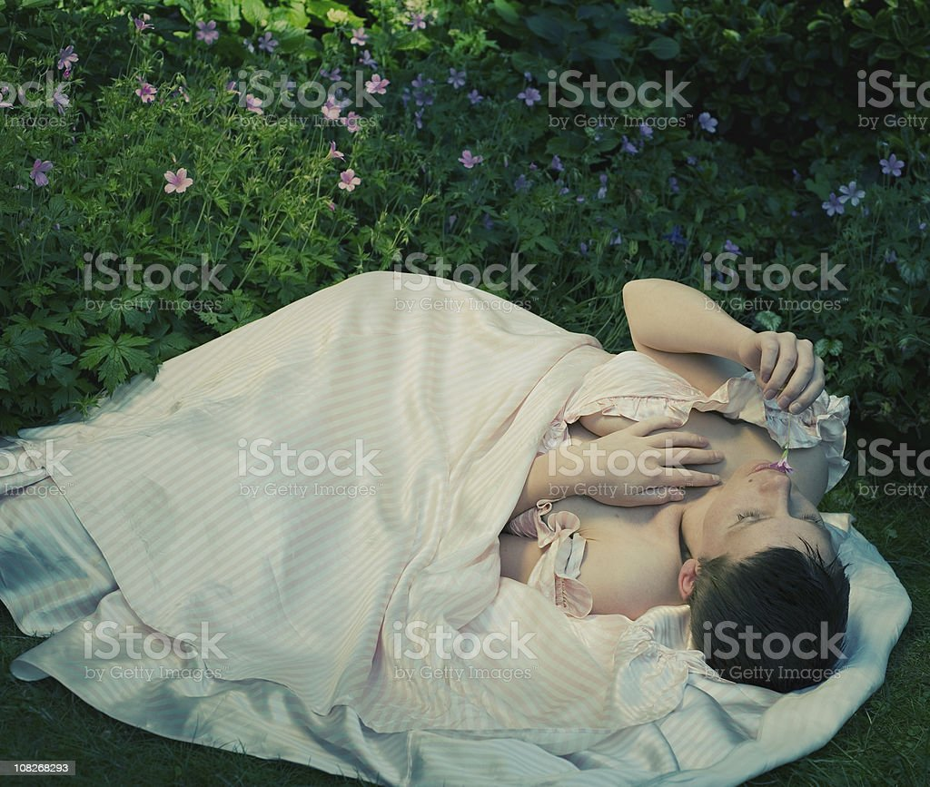 Woman lying in Garden stock photo
