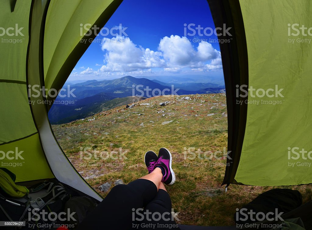 Woman lying in tent stock photo