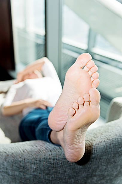 Woman lying on a couch stock photo