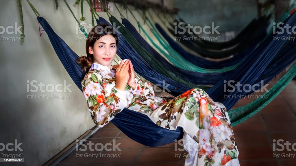 woman lying on a hammock inside cafe  in Vietnam (the this like cafe hammock has a lot in Vietnam) royalty-free stock photo