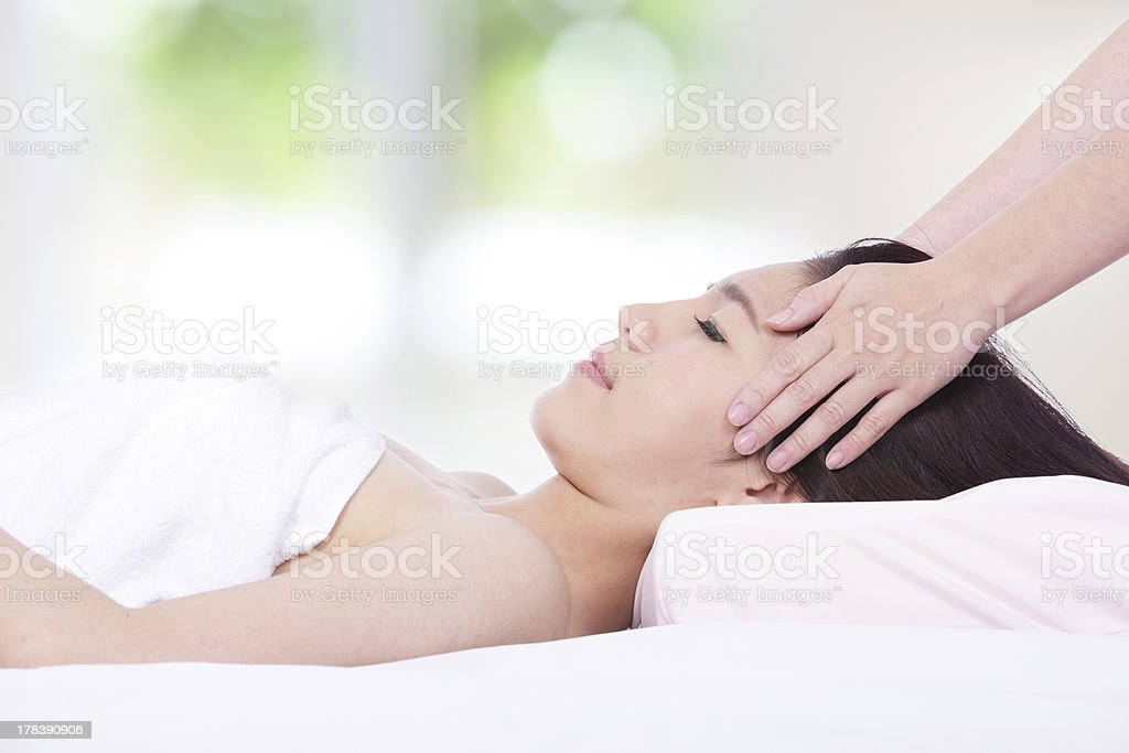 woman lying on a massage table in health spa stock photo