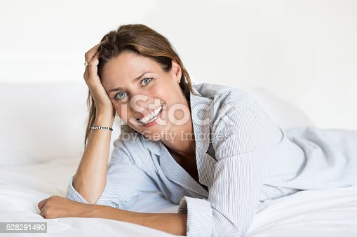 istock Woman lying on bed 528291490