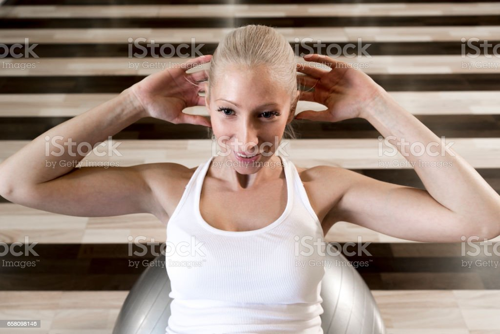 Woman Lying on Fitness Ball and Doing Sit Ups royalty-free stock photo