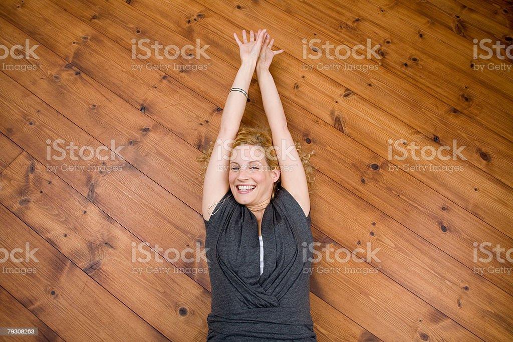 Woman lying on floor 免版稅 stock photo