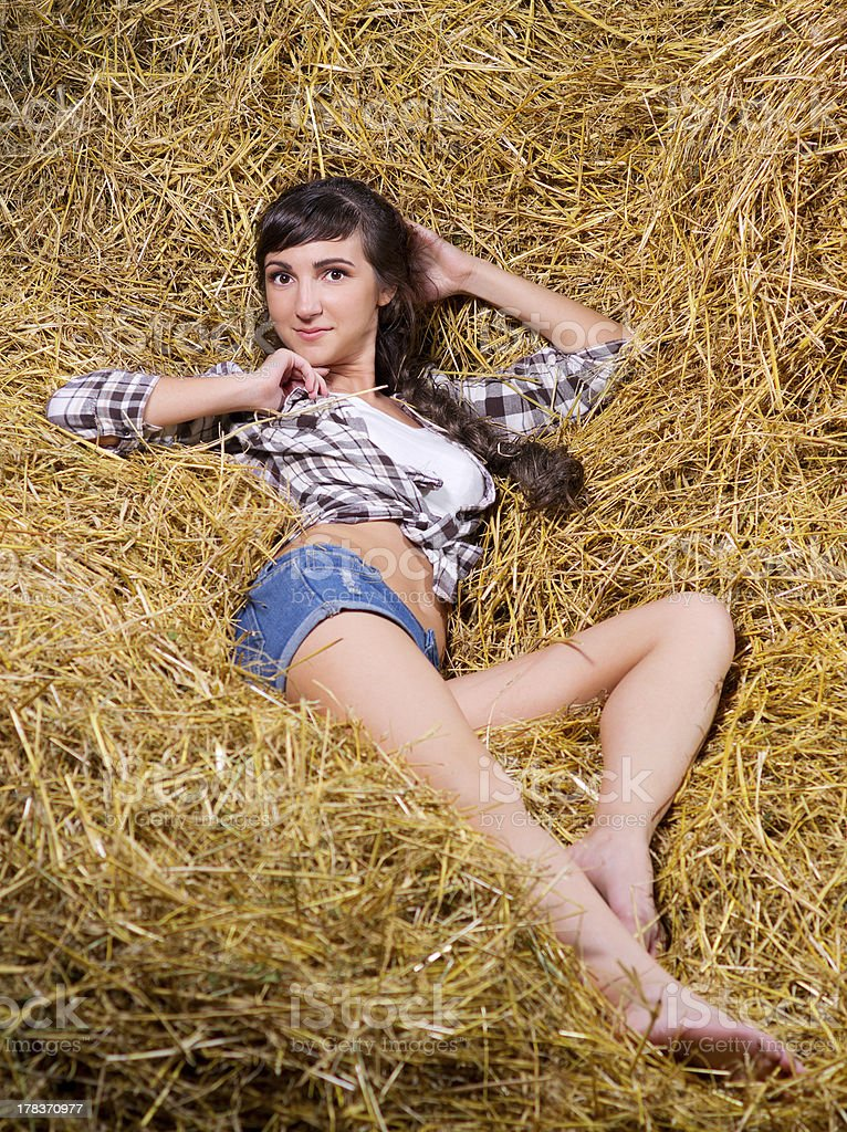 Woman lying on haystack royalty-free stock photo