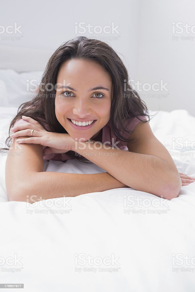 Woman lying on her bed royalty-free stock photo