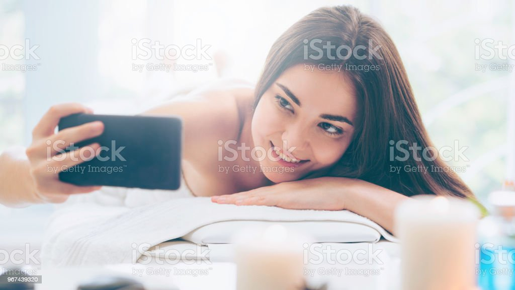 Woman lying on spa bed for massage in luxury spa. stock photo