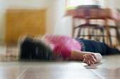 istock Woman lying on the floor at home, epilepsy, unconsciousness, faint, stroke, accident or other health problem. 1142838874