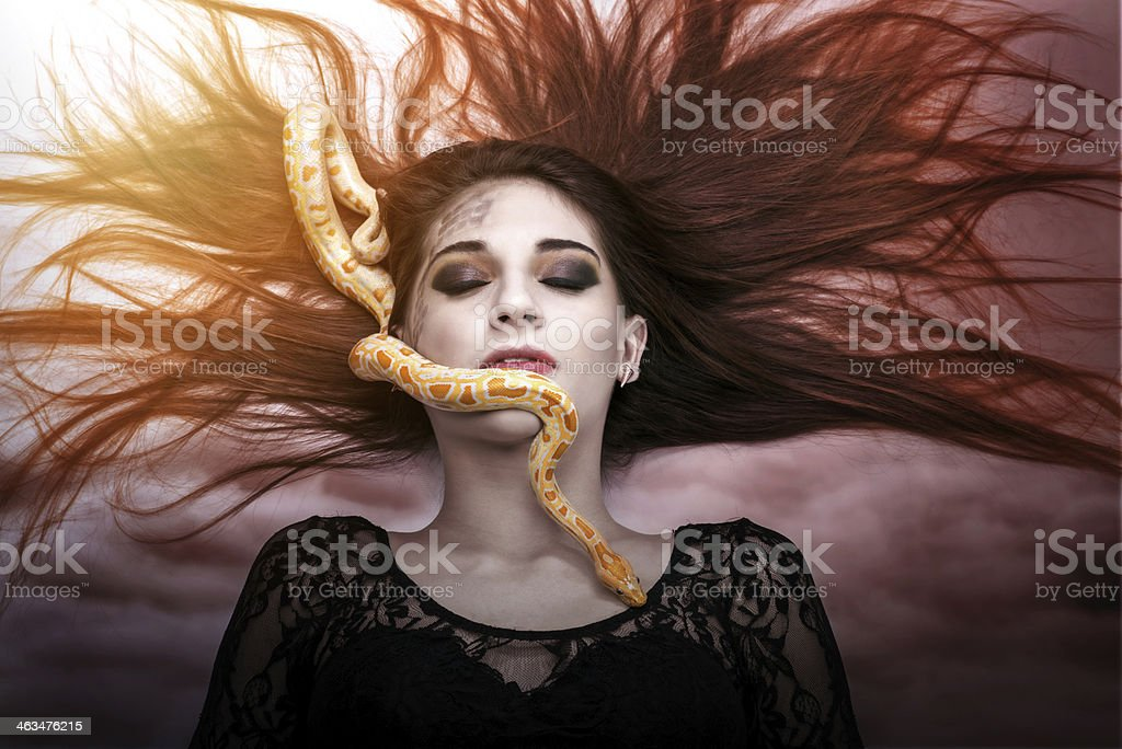 Woman lying on the floor with eyes closed stock photo