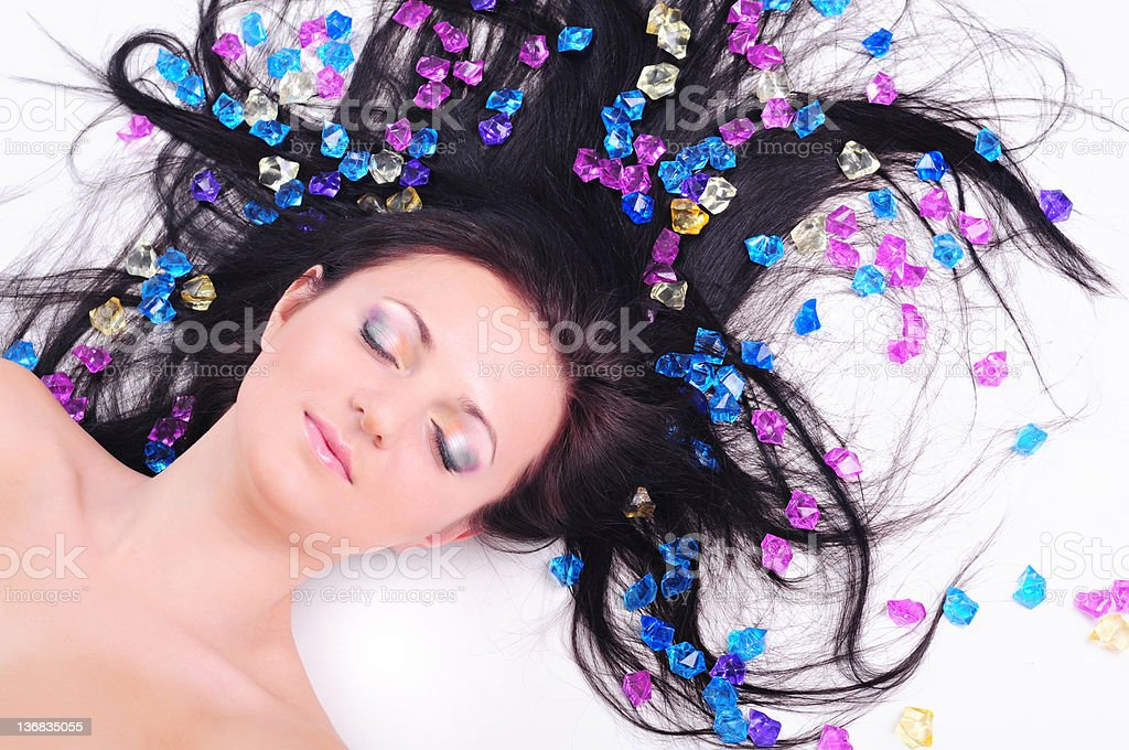 woman  lying on white background with beautiful hair all over royalty-free stock photo