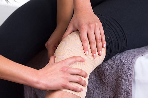 woman lying while getting a leg massage concept of physiotherapy Close up shot of young woman lying while getting an leg massage after injury from specialist concept of physiotherapy disjointed stock pictures, royalty-free photos & images
