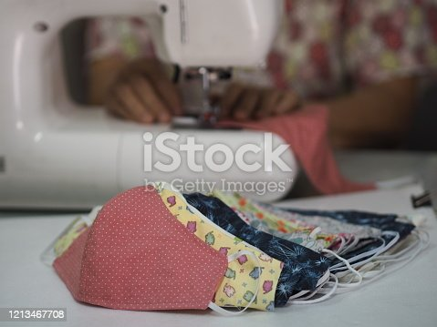 Woman made mask self prevention ill made of fabric for dust and germs pm 2.5, virus covid 19