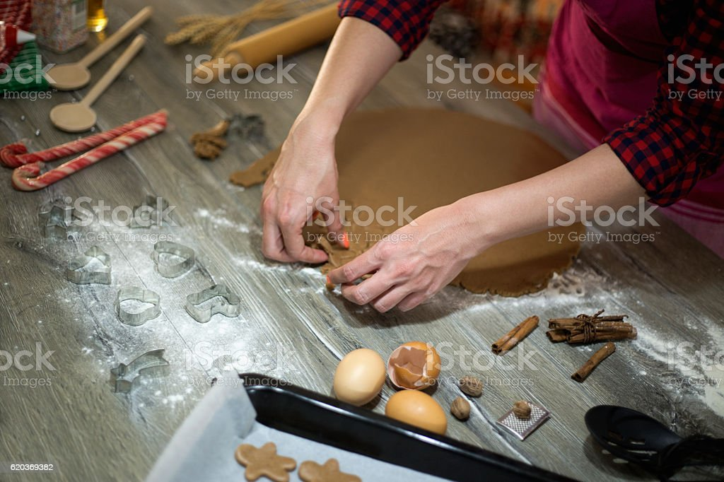 Woman make ginger bread for Christmas. Natural Colors. Real life foto de stock royalty-free