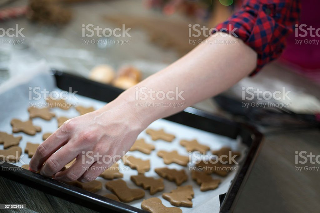 Woman make ginger bread for Christmas. Natural Colors. Real life foto stock royalty-free