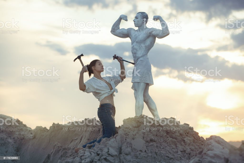 Woman makes a living statue. stock photo