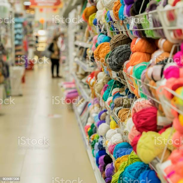 Woman makes choosing yarn for knitting in the store of goods for and picture id905687006?b=1&k=6&m=905687006&s=612x612&h=bjzlh43s cts384r987mdf9qbj5tty547sfl2ahssxc=