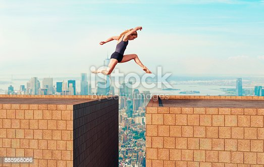 Female with bare feet runs and jumps from one tall building to another. She looks down as she is right a above the gap between the buildings. Big city in the background with skyscapers. Concept of taking a change even though there is a big risk.