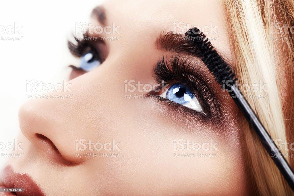 Woman Make-up Applying closeup. Eyeliner. Cosmetic Eyeshadows stock photo