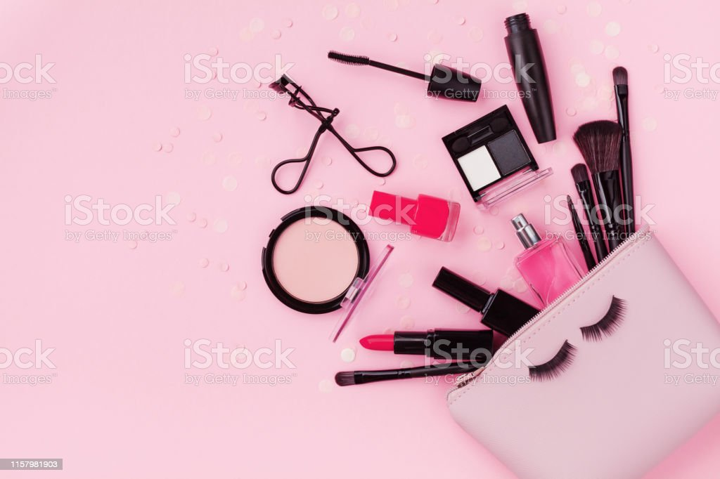Woman makeup background with beauty products and cosmetics. Top view...