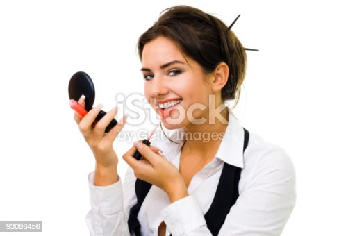 109721176istockphoto Woman makeup herself 93086456