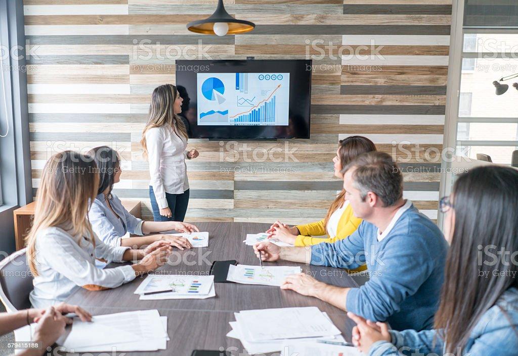 Woman making a business presentation stock photo