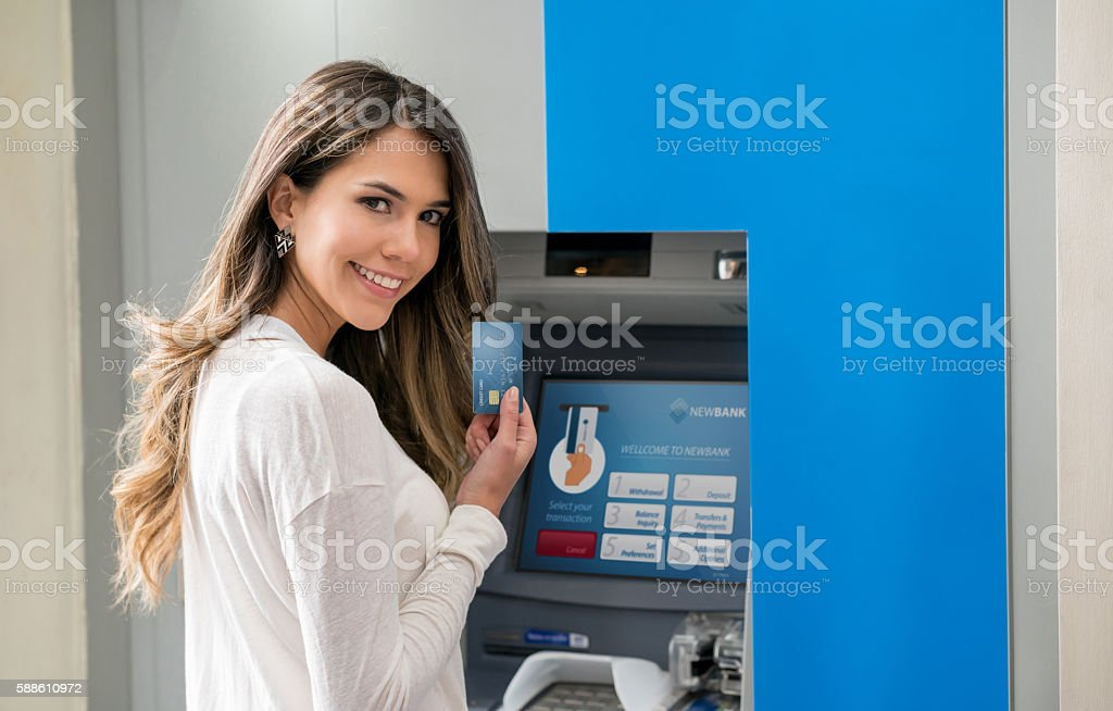 Woman making a cash withdrawal stock photo