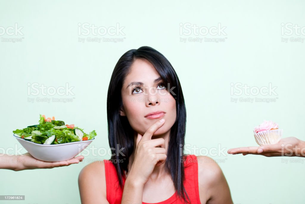 Woman making a decision on nutrition royalty-free stock photo