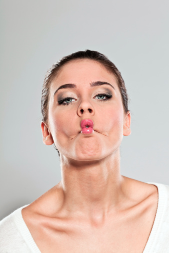 Woman Making A Face Stock Photo - Download Image Now
